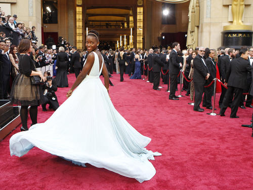 Lupita Nyong'o arrives at the 86th Annual Academy Awards in March 2014 at the Dolby Theatre at Hollywood & Highland Center.
