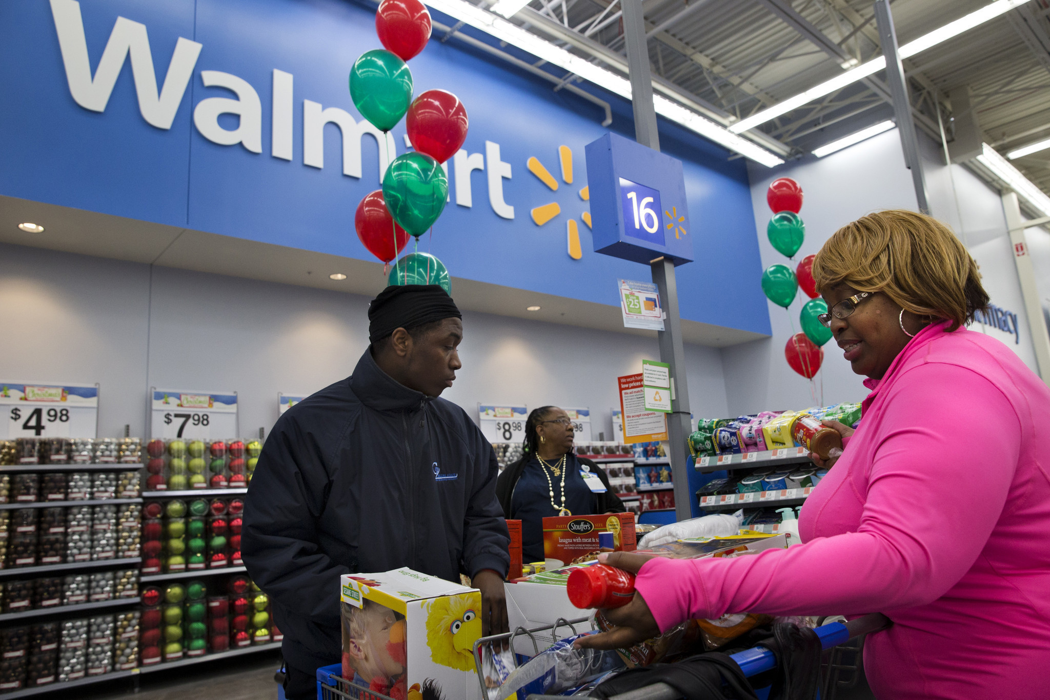 wal mart pay hike raises hopes of workers and shoppers la times