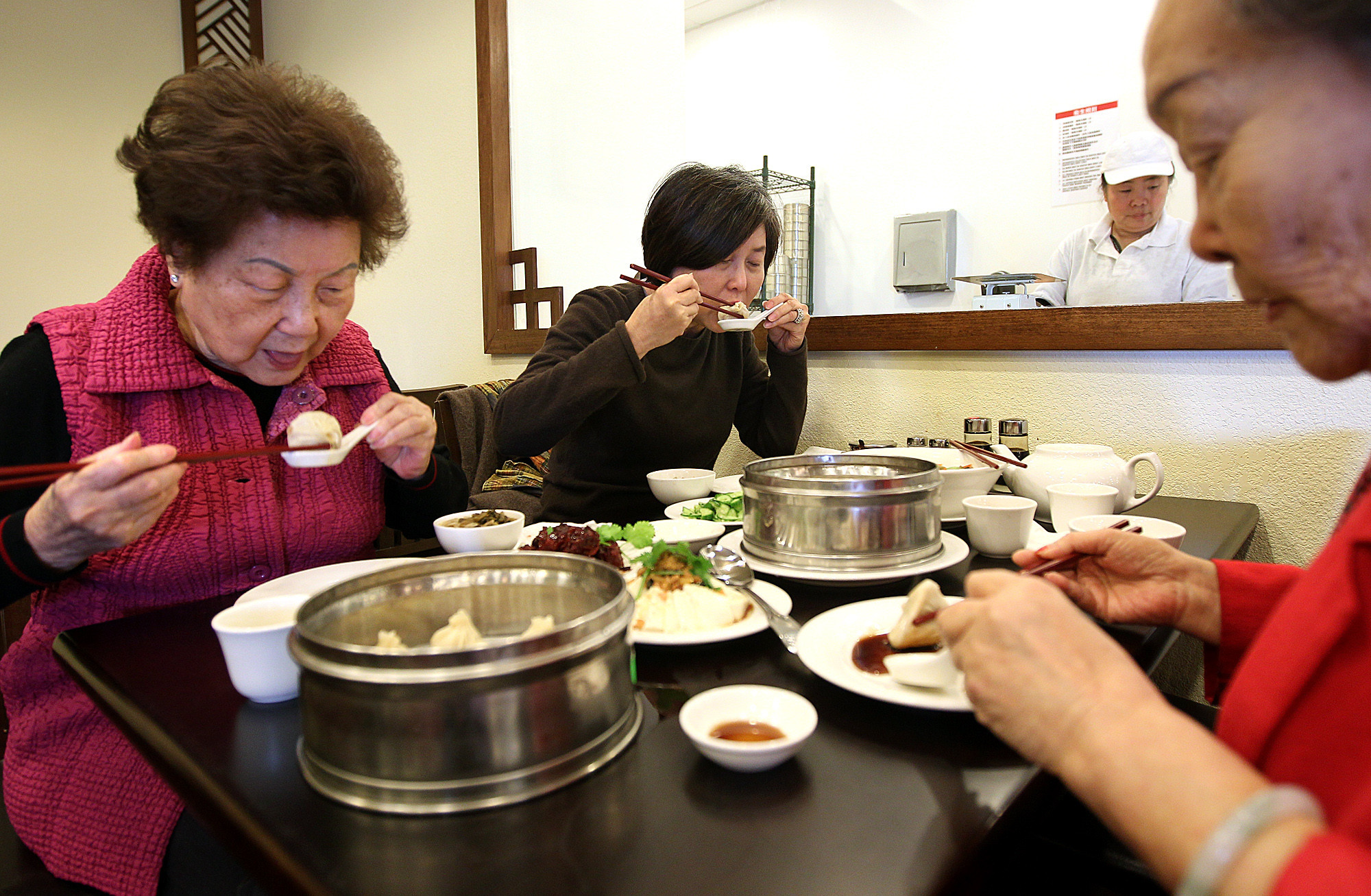Coco Chang, left, of Whittier, her daughter Fanny Yuan, of Walnut, center, and friend Ann Wu, of Monterey Park share lunch at Wang Xing Ji in San Gabriel.