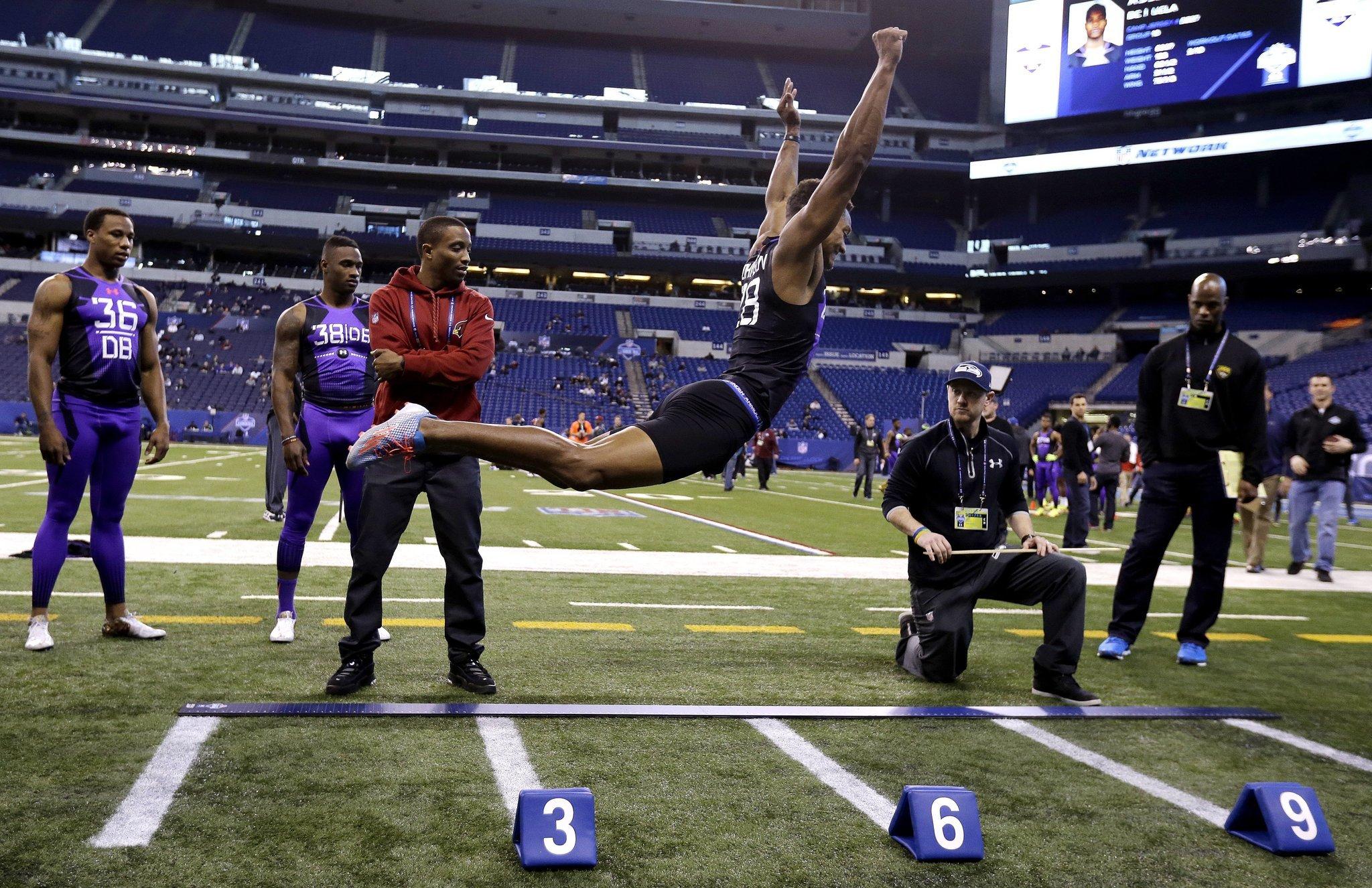 UConn CB Byron Jones beats broad jump world record at NFL bine