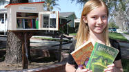 Burb's Eye View: A young book lover runs her own free library