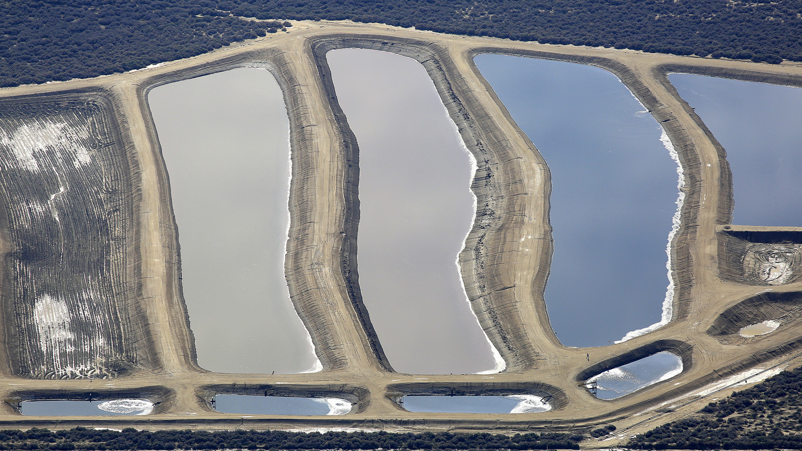 Who's behind the chemical-laden water pits in Kern County?