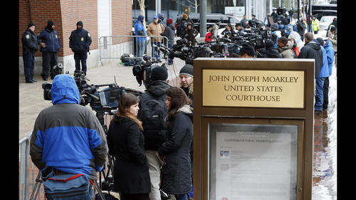 Members of the media wait outside federal court, Wednesday, March 4, 2015, in Boston, on the first day of the federal death penalty trial of Boston Marathon bombing suspect Dzhokhar Tsarnaev.
