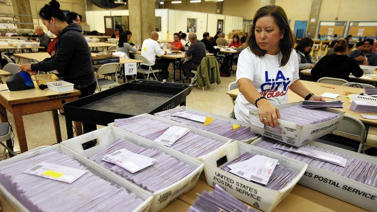 L.A. officials sort uncounted ballots from the Los Angeles primary election in 2015. (Genaro Molina / Los Angeles Times)