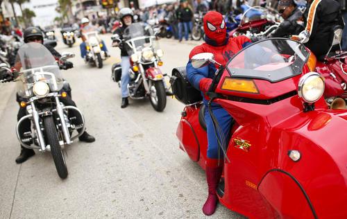 Spider-man cruised along Main Street in Daytona Beach during Bike Week 2015 on March 7, 2015.  (Jacob Langston/Orlando Sentinel)