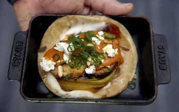 Sweet potato tacos with leeks and almond salsa