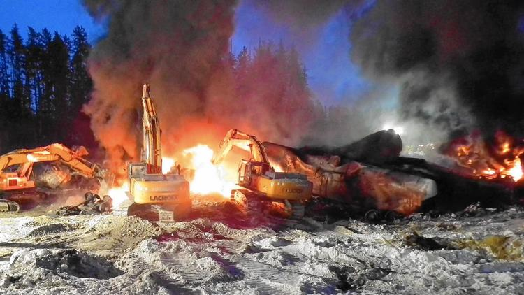 Flames erupt from the scene of a crude-oil train derailment Feb. 16 near Timmins, in Ontario, Canada. (Transportation Safety Board of Canada)