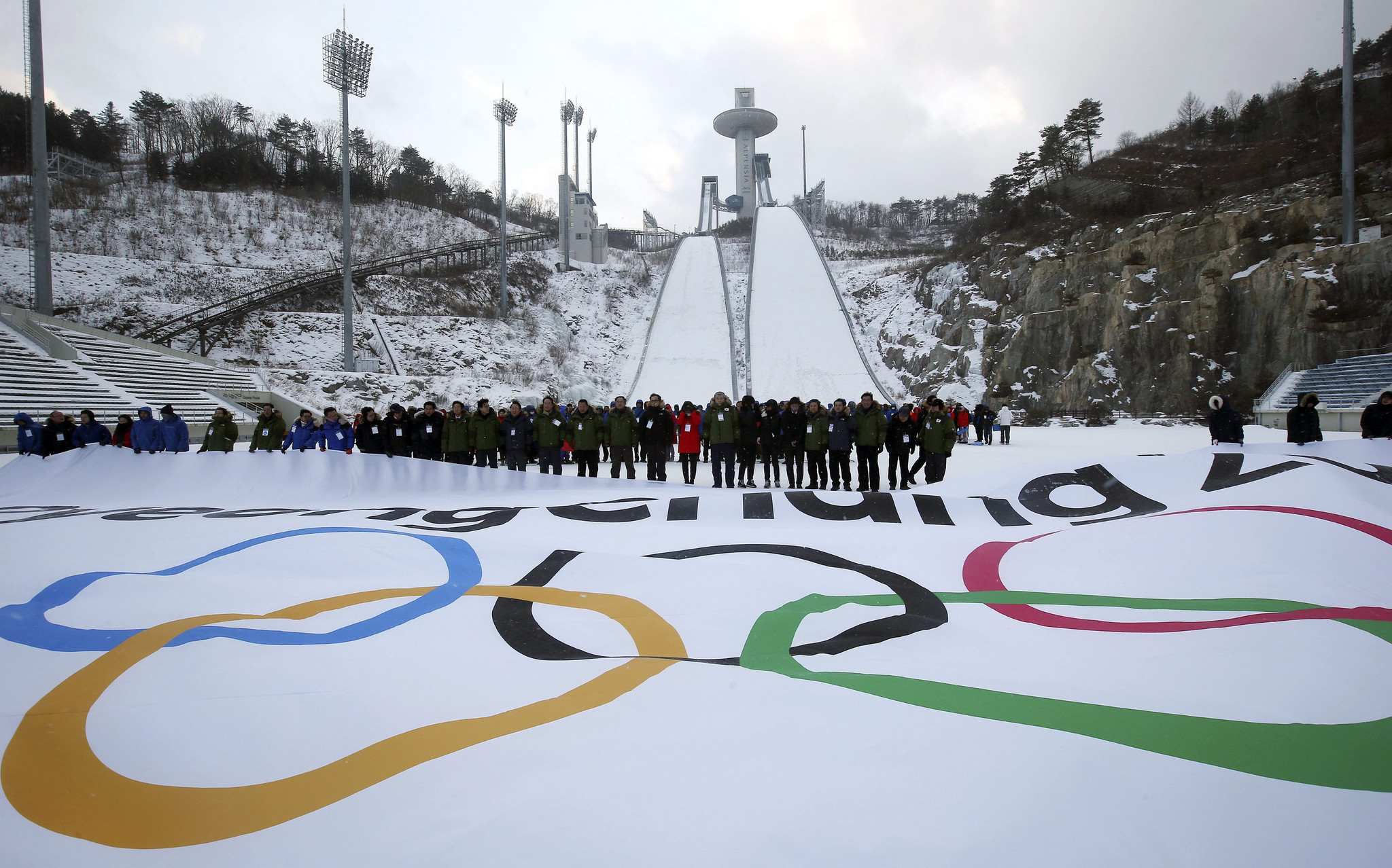 Olympic officials deliver mixed message on 2018 Winter Games