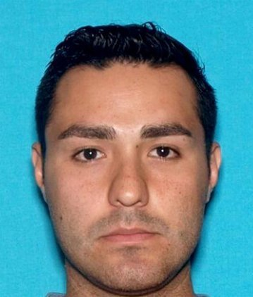 Fired LAPD cop charged with murder in Pomona slaying, still at large