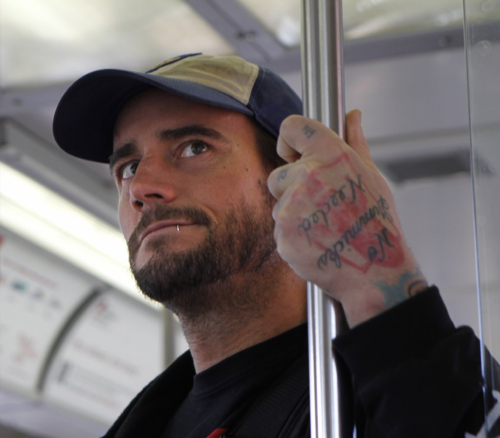WWE Champion CM Punk rides the CTA Blue Line March 8, 2012.