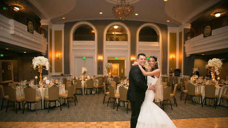 Catharine Paules and Randall Bielski; Ceremony venue: Loyola Blakefield chapel, reception venue: Lord Baltimore Hotel