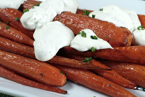 "Connie and Ted's roasted carrots with rosemary butter and black pepper crème fraîche. <a href=""http://recipes.latimes.com/recipe-connie-and-teds-roasted-carrots/"" target=""_blank"">Read the recipe »</a>"