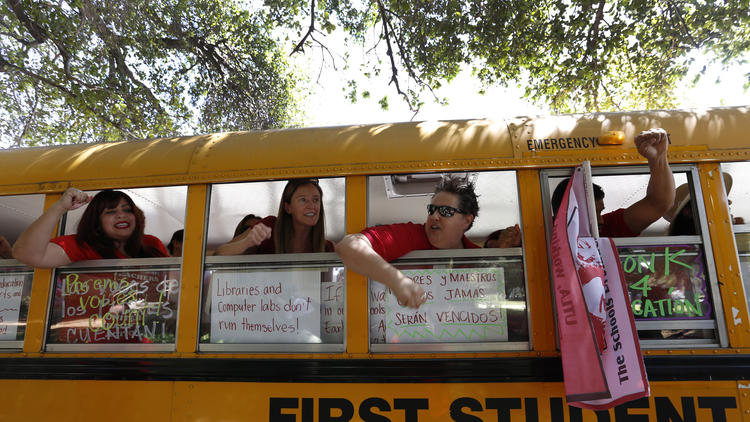 The L.A. Board of Education approved a new multibillion-dollar benefits package on a day that teachers staged demonstrations at three schools.
