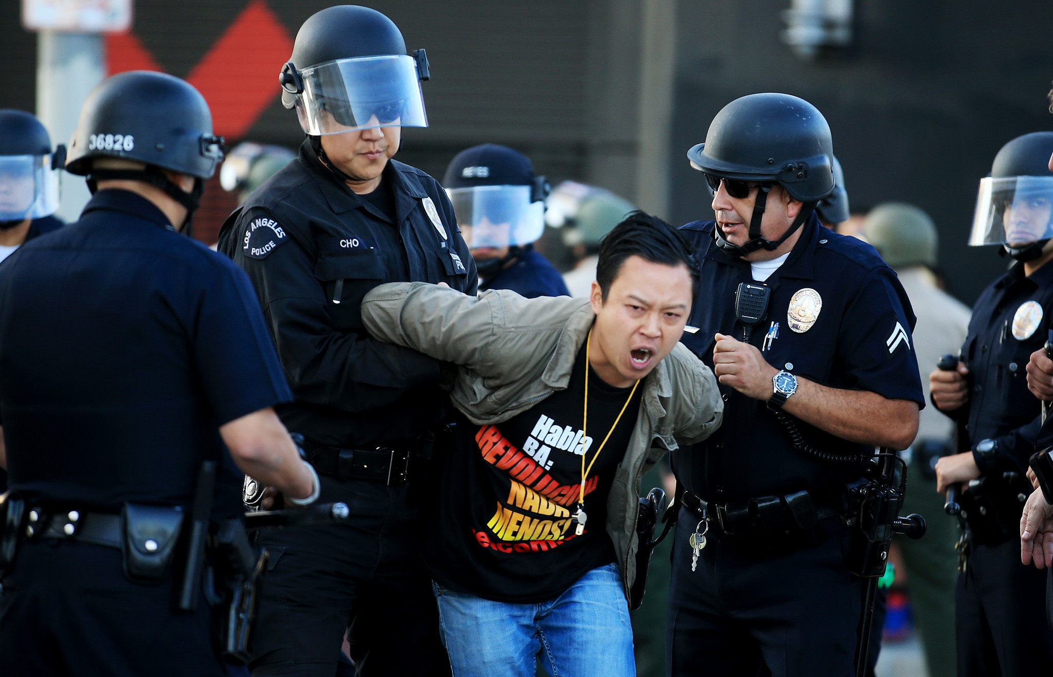 Police arrest a protester during an anti-lockdown protest