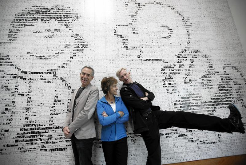 "Cartoonist Charles Schulz's son Craig, right, clowns around under a museum mural with Schulz's widow, Jeannie, and Steve Martino, director of ""The Peanuts Movie."" (Bob Chamberlin / Los Angeles Times)"