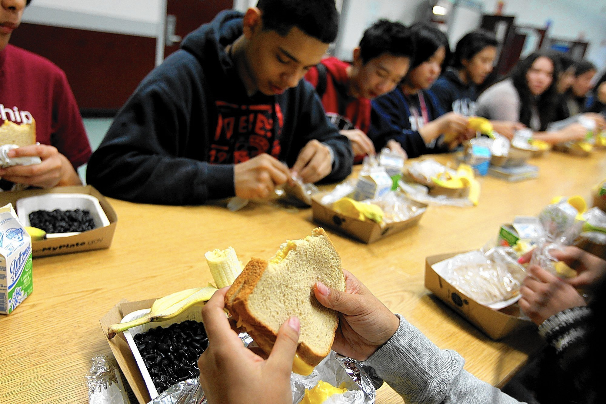 Students eat lunch at Francisco Bravo Medical Magnet High School in Los Angeles. (Christina House / For the Los Angeles Times)