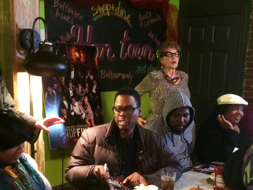 """Actor and director Chris Rock signs autographs at Cafe Hon in Hampden while promoting his new film, """"Top Five."""""""