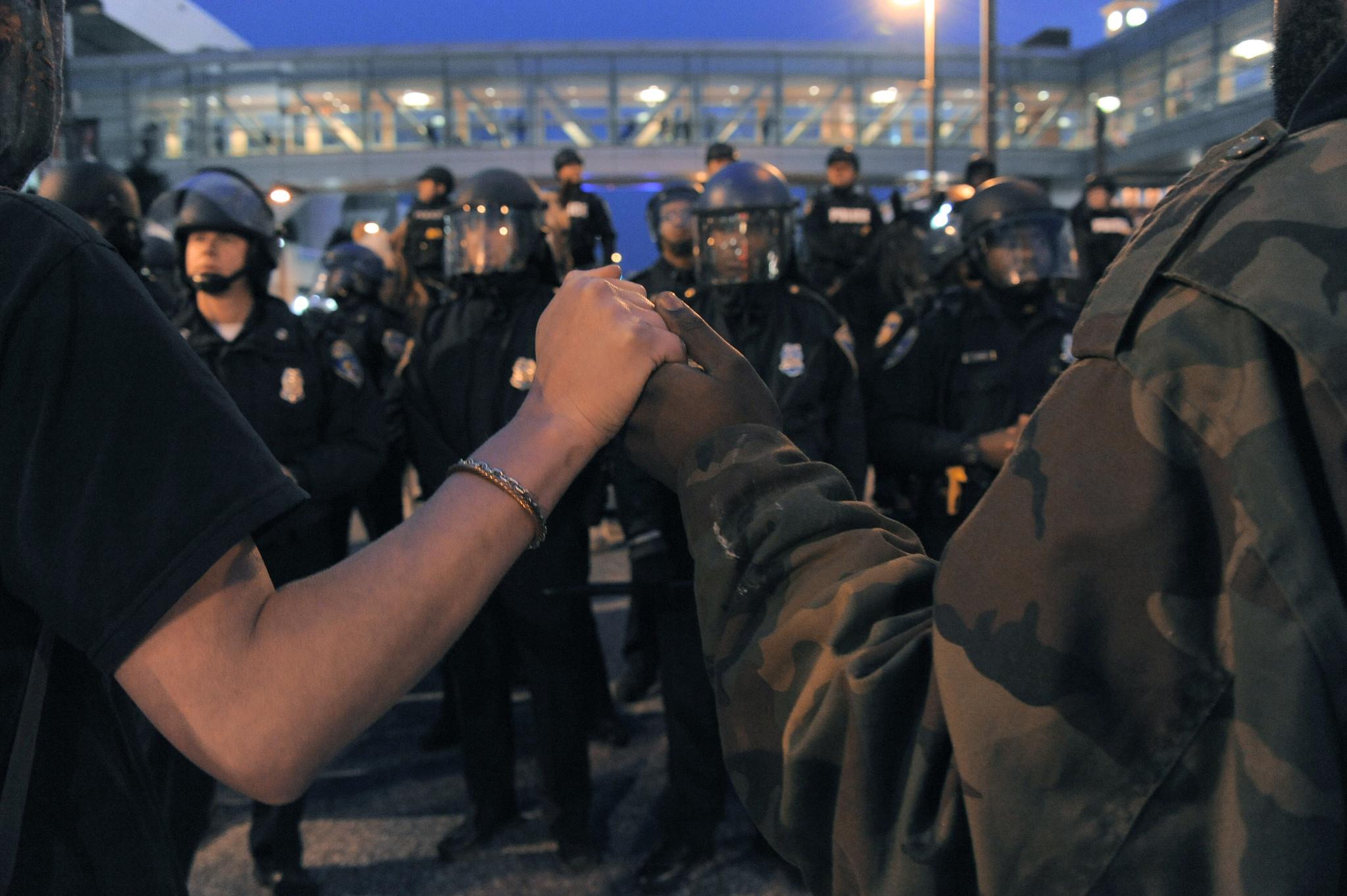 Baltimore police arrest 35, 6 officers injured in protest