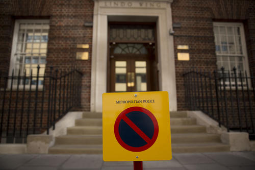 A restricted parking sign stands outside the Lindo Wing of St Mary's Hospital, London, Friday, April 17, 2015. Britain's Kate the Duchess of Cambridge is expected to give birth to her second child with her husband Prince William at the hospital in the coming weeks.