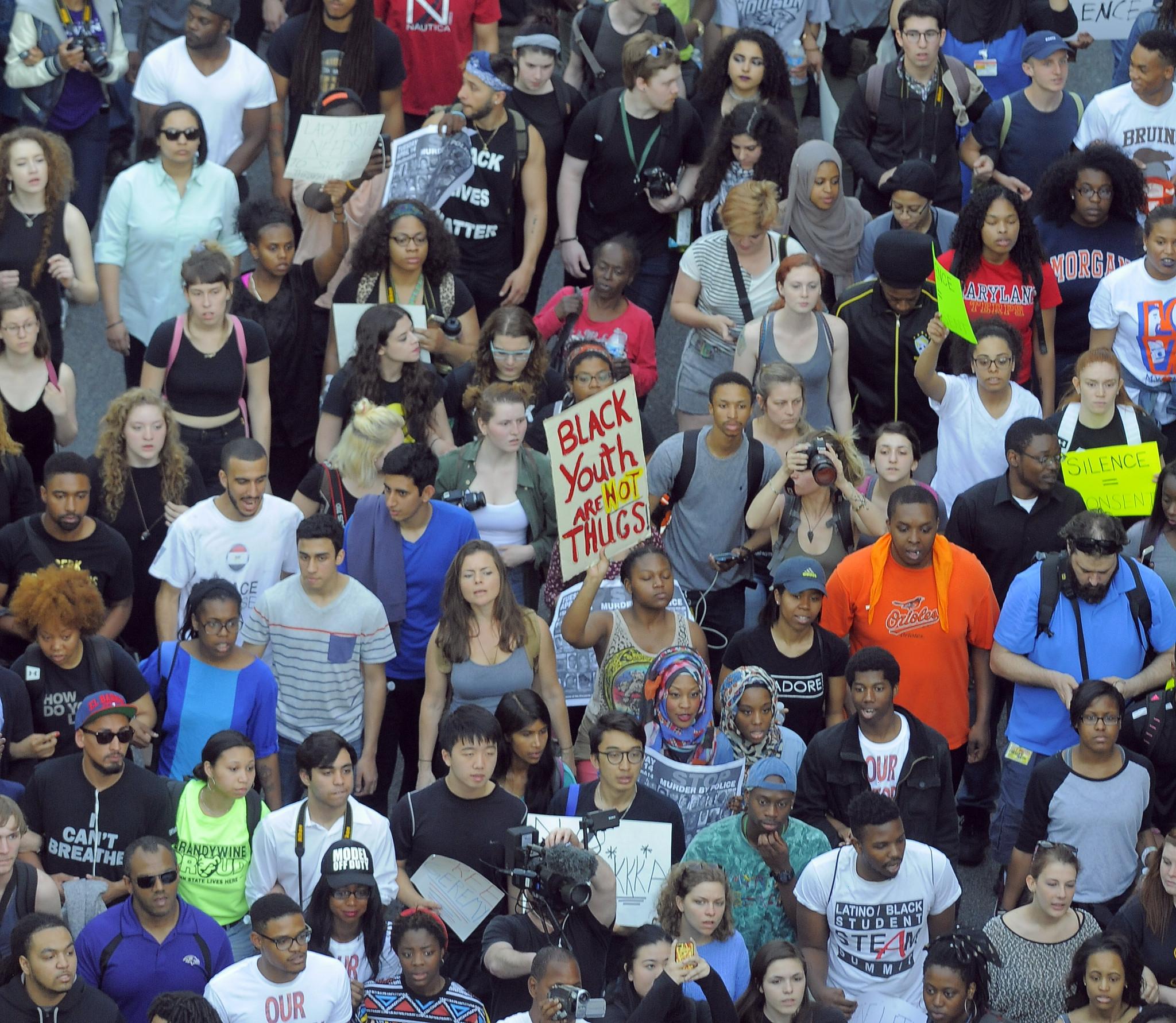 Baltimore protests continue as city mourns