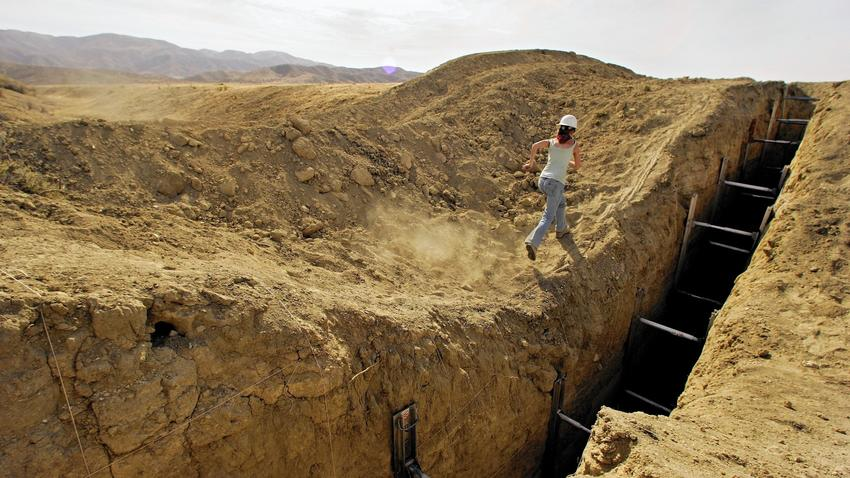 Studying a trench that reveals lines in the sediment helps a team of geologists construct a history of earthquakes on the San Andreas fault in San Luis Obispo County.