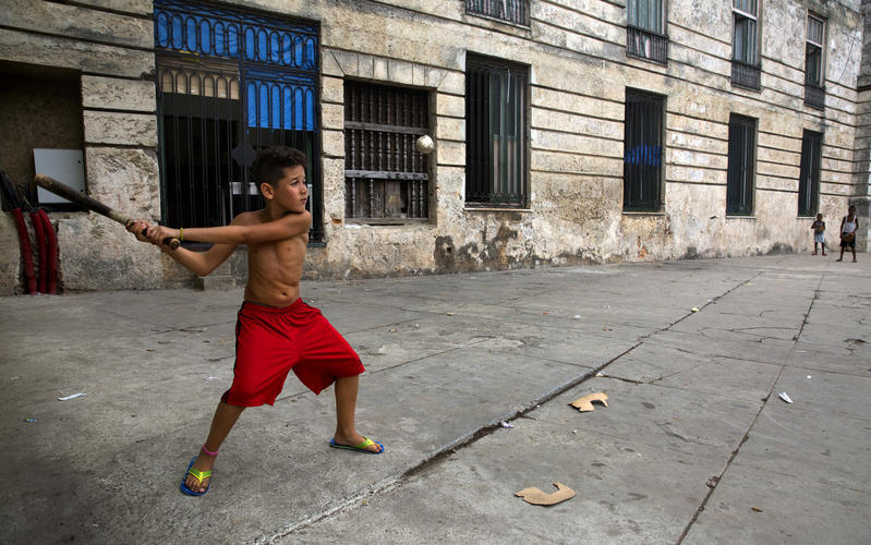 boy playing stickball