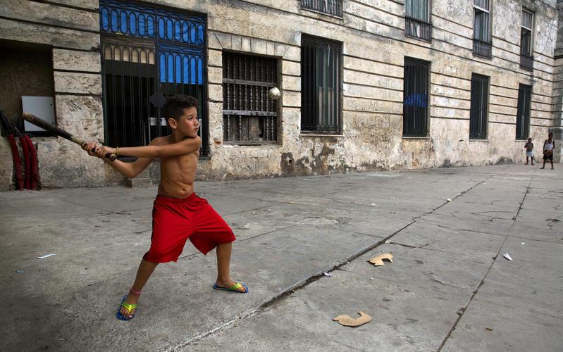 boy playing stickball