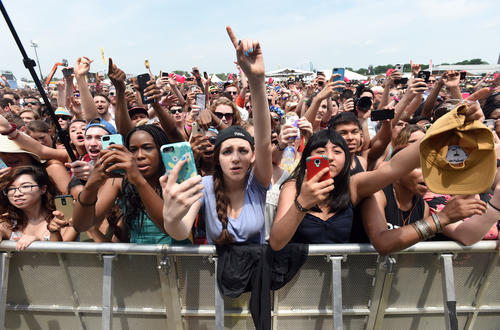 "<p>Fans enjoy ""Childish Gambino"" performing on the main stage on the infield during the 140th Preakness.</p>"