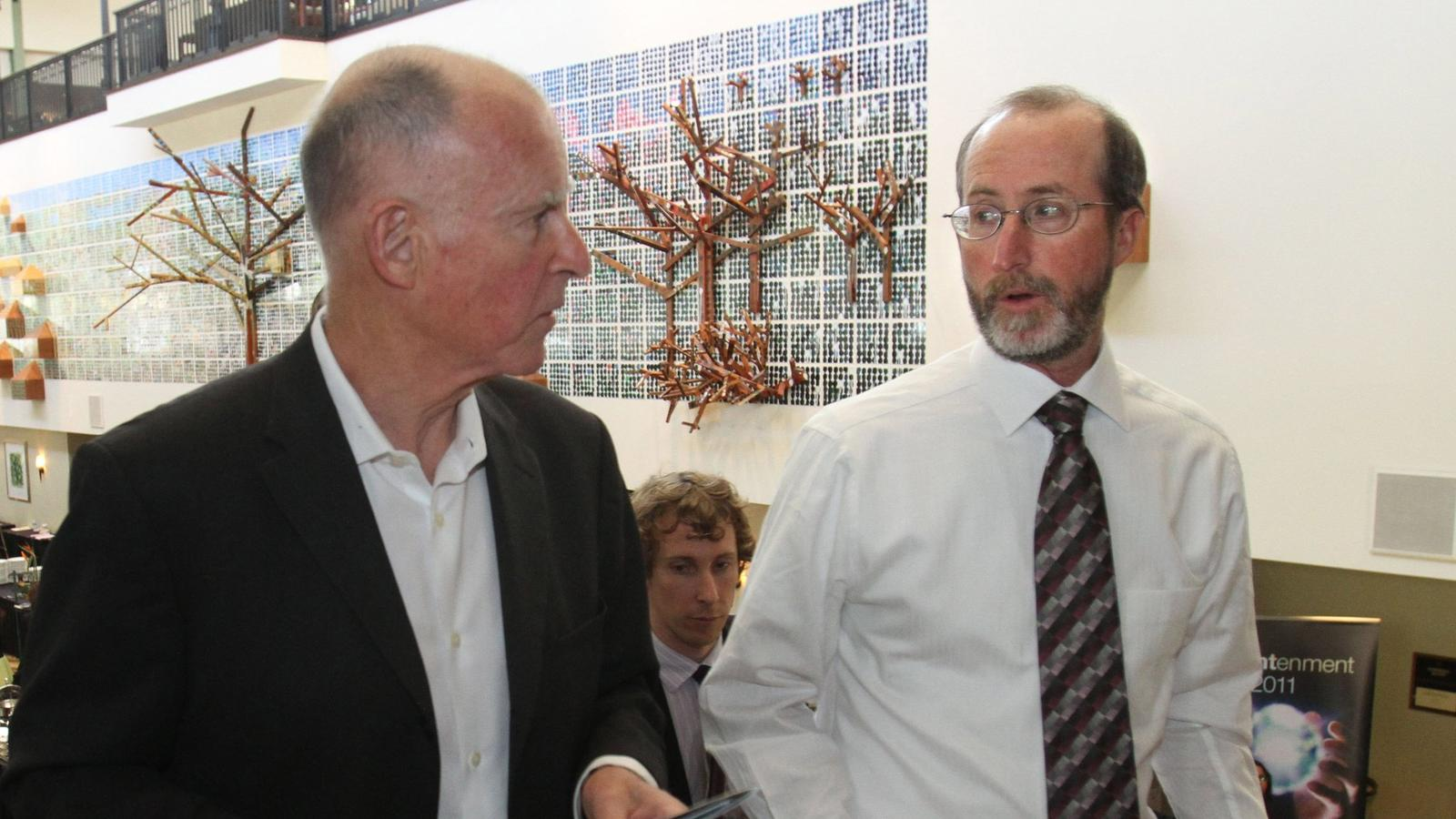Gov. Jerry Brown speaks with Steve Glazer, then mayor of Orinda, in 2011. (Rich Pedroncelli / Associated Press)