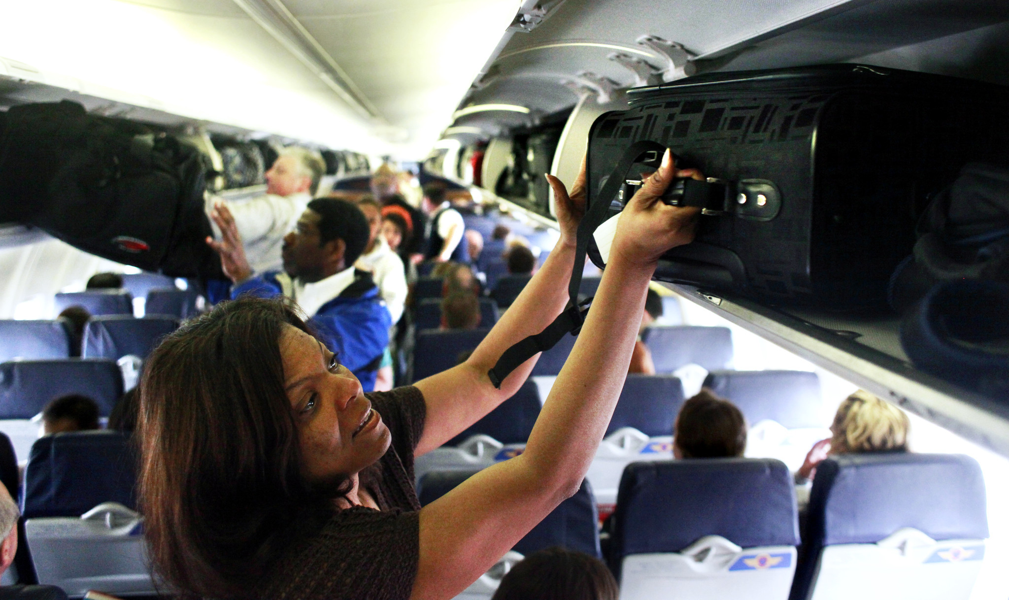 Baggage Battle Fight For Overhead Bin Space Chicago Tribune