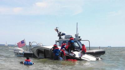 Police rescue 7 from capsized motorboat