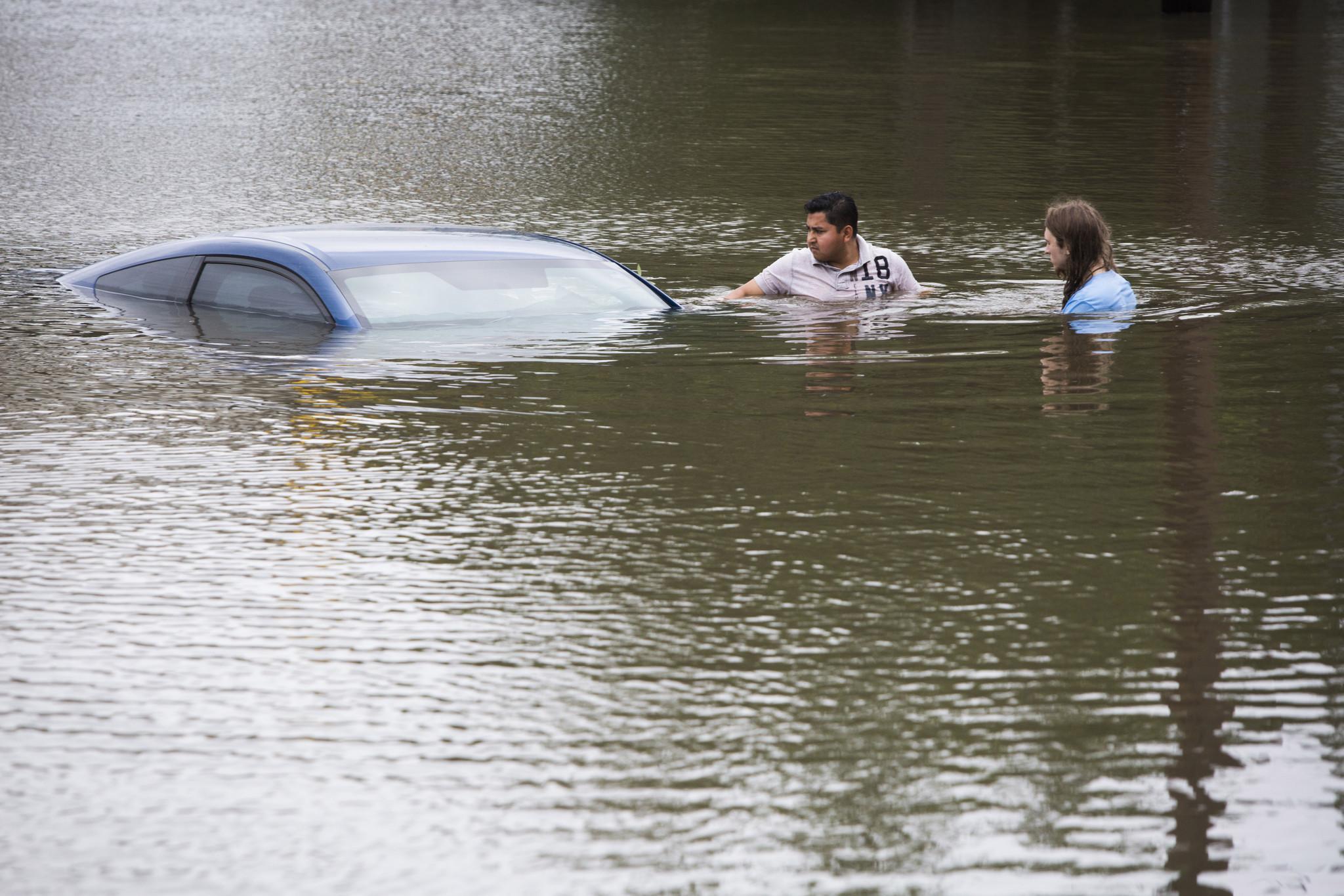 Floodwaters deepen in Houston as more rain falls; about a dozen still missing