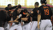 Darren O'Day's escape, J.J. Hardy's single give O's 2-1 walk-off win over Rays