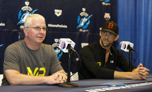 <p>Bob Bowman, left, answers a question as Michael Phelps looks on at a news conference at the Arena Pro Swim Series swim meet in Charlotte, N.C.</p>