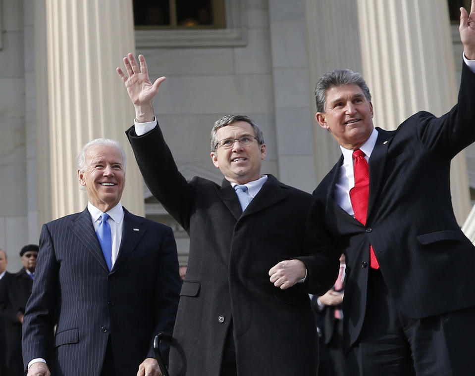 <p>Sen. Mark Kirk, R-Ill., left, waves Jan. 3, 2013, after returning to work at the U.S. Capitol in Washington. He received a bipartisan welcome, including from Vice President Joe Biden, from far left, Sen. Joe Manchin, D-W.Va., and Sen. Dick Durbin, D-Ill.</p>