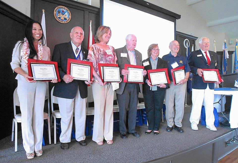 Inductees JoAnn Holman, James Peter Schabarum, Shelli Zeller (for husband Bill Zeller), Jack Mills, Joan Parks, Ed Romeo, and Dan O'Sullivan, stand following the annual American Legion Community & Service Clubs Hall of Fame awards and luncheon on Friday.