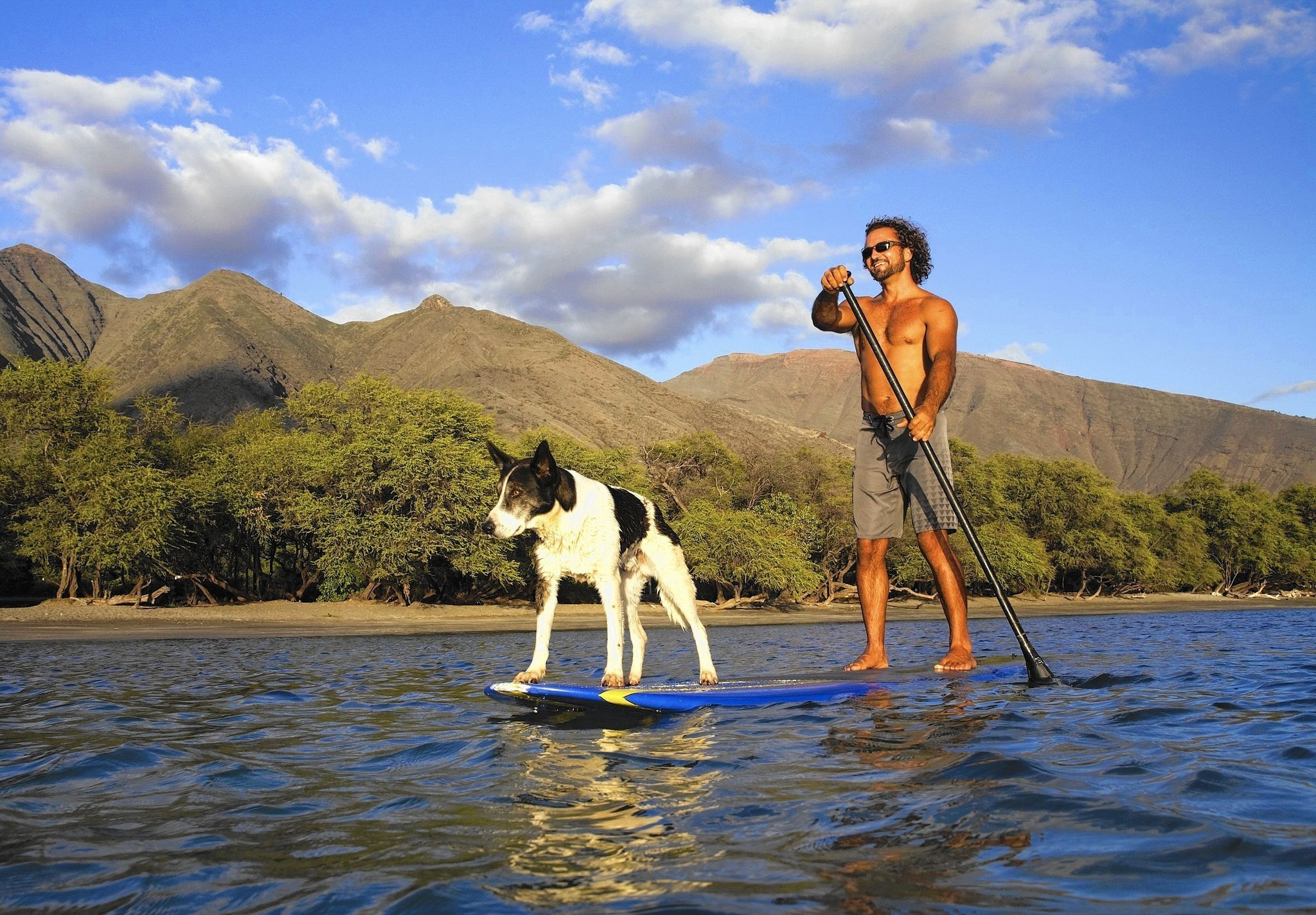 Stand Up Paddling With Dog Wearing Doggles