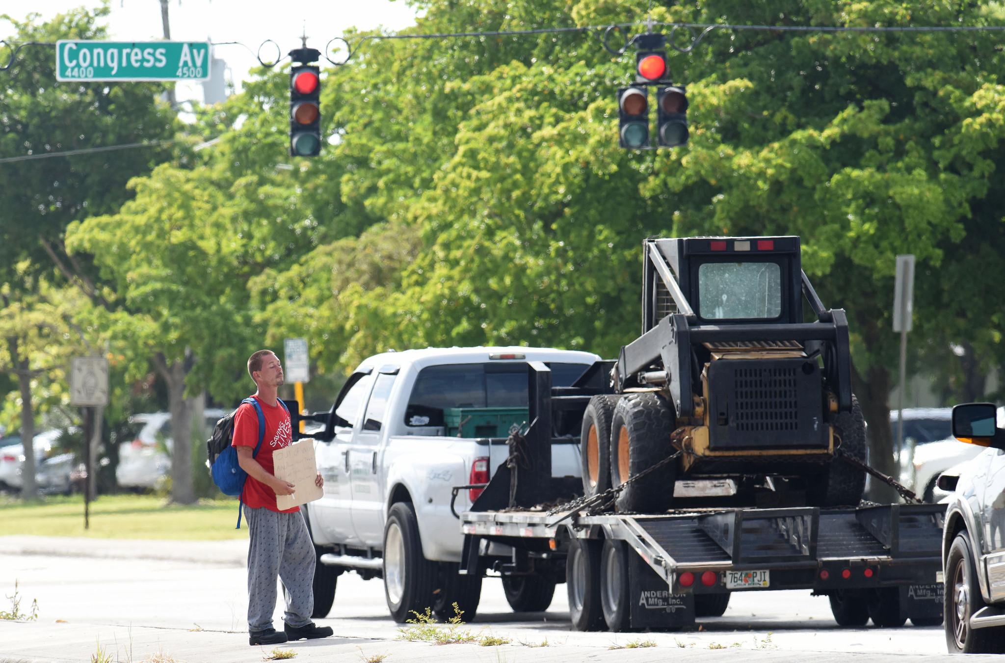 Palm Beach County bans panhandling, fundraising on roads - Sun Sentinel