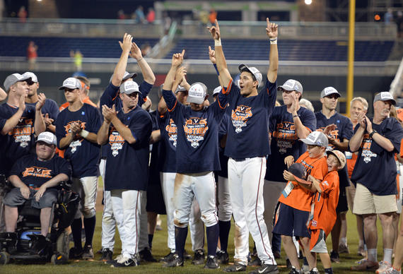 Virginia players and others celebrate winning Game 3, 4-2, at the best-of-three NCAA baseball College World Series finals against Vanderbilt at TD Ameritrade Park in Omaha, Neb., Wednesday, June 24, 2015. (AP Photo/Ted Kirk) ORG XMIT: TXTG149