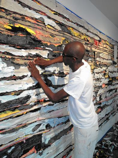 Artist mark bradford is seen here working on his quot pull painting quot at