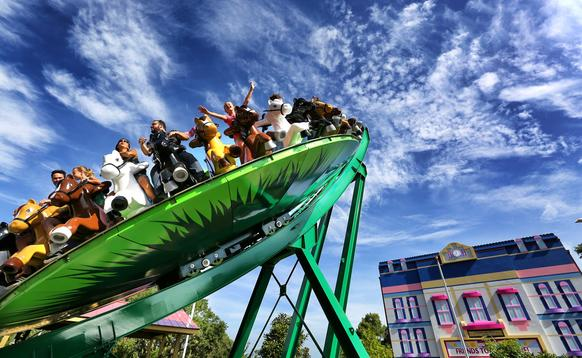 Young fans cheer as they ride Mia's Riding Adventure, a horse-themed, spinning thrill ride, on opening day of the new Heartlake City section of Legoland Florida, Thursday, June 25, 2015. (Joe Burbank/Orlando Sentinel)  B584733088Z.1