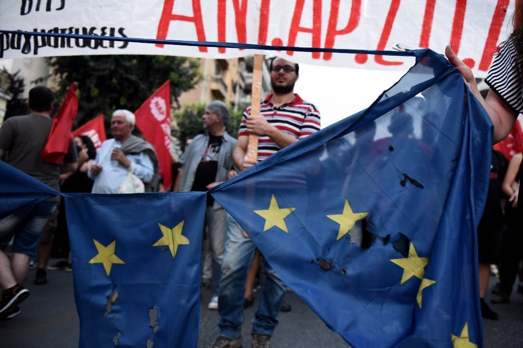 Greece in limbo: Shuttered banks keep lifeline