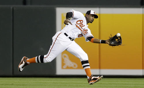 <p>Baltimore Orioles center fielder Adam Jones catches a fly ball that was his by Seattle Mariners' Mike Zunino in the ninth inning of a baseball game, Tuesday, May 19, 2015, in Baltimore. Baltimore won 9-4. </p>
