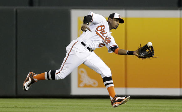 <p>Baltimore Orioles center fielder Adam Jones catches a fly ball that was his by Seattle Mariners' Mike Zunino in the ninth inning of a baseball game, Tuesday, May 19, 2015, in Baltimore. Baltimore won 9-4.</p>