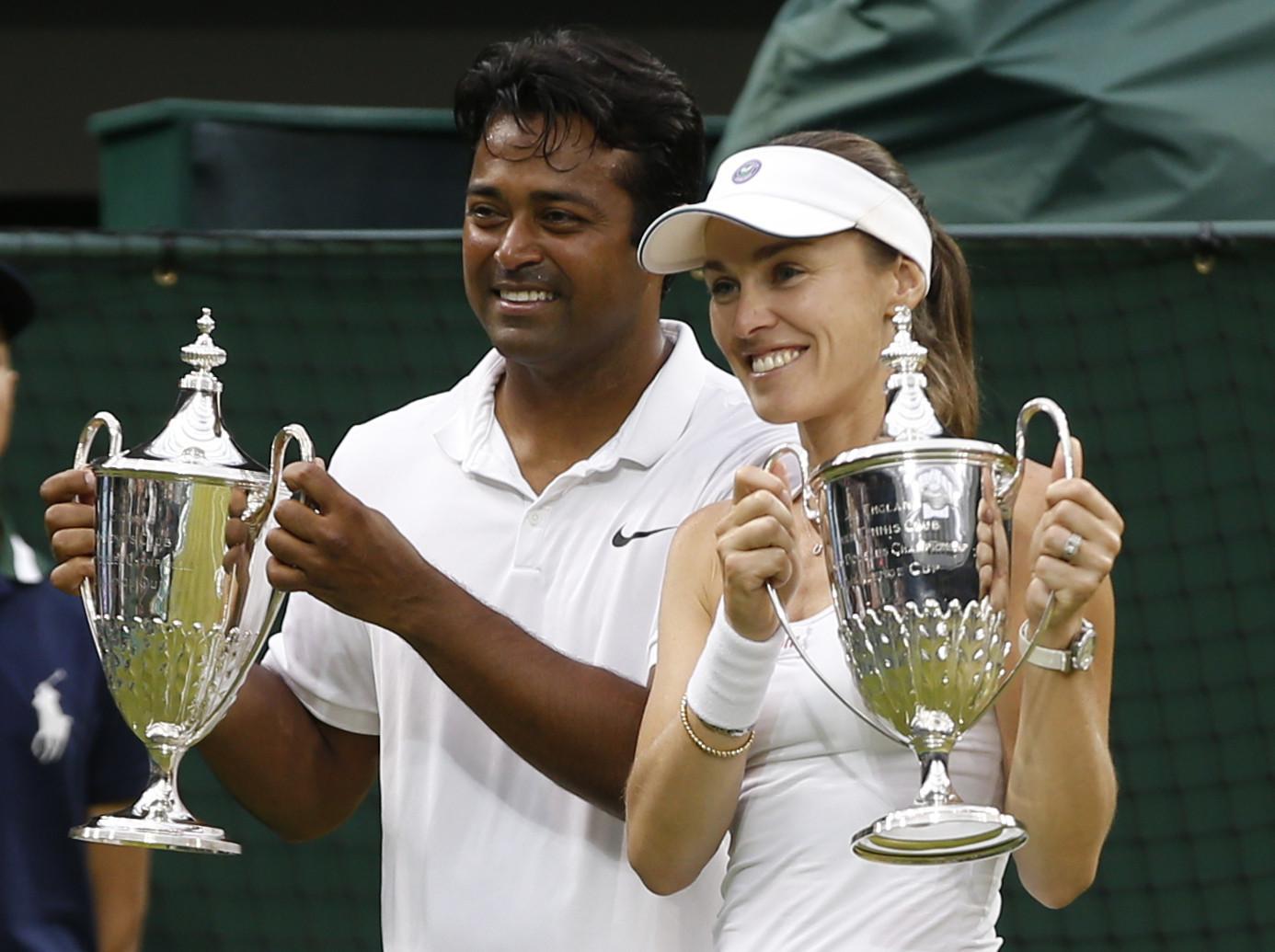 Martina Hingis wins Wimbledon mixed doubles for 2 titles in 2 days
