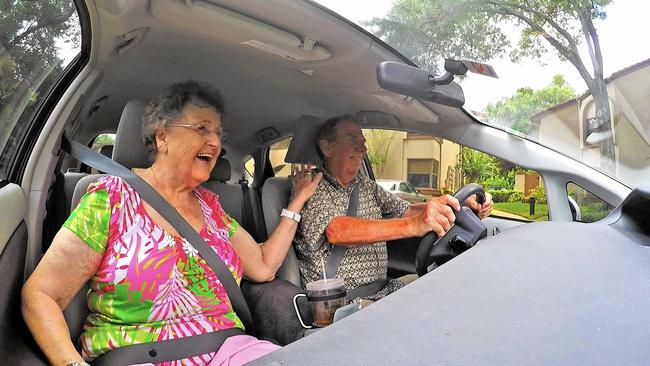 Ruth Combs, 80, of Orlando, who does not drive, gets a ride from John McCallister, 76, a volunteer driver for ITN Orlando.