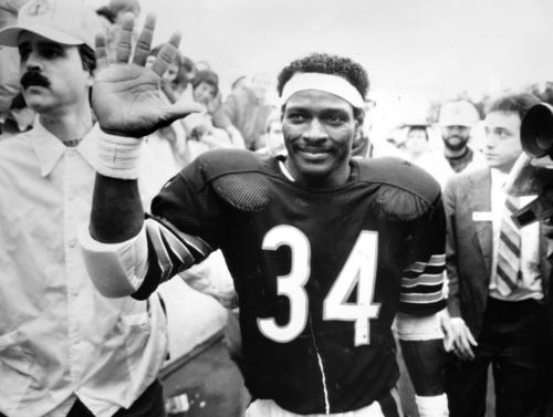 <p>The Bears' Walter Payton acknowledges the cheers of the crowd after his record-setting afternoon Oct. 7, 1984. He overtook Jim Brown's NFL rushing record during the game. </p>