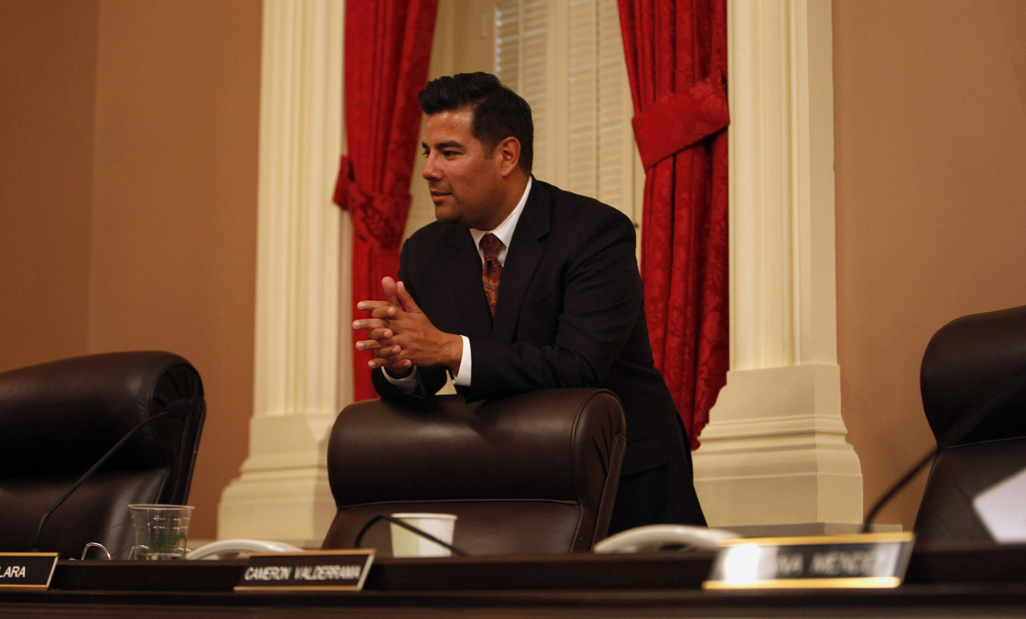 Sen. Ricardo Lara (D-Bell Gardens) rests on his chair during a break in a Senate Rules Committee meeting in Sacramento. (Katie Falkenberg / Los Angeles Times)