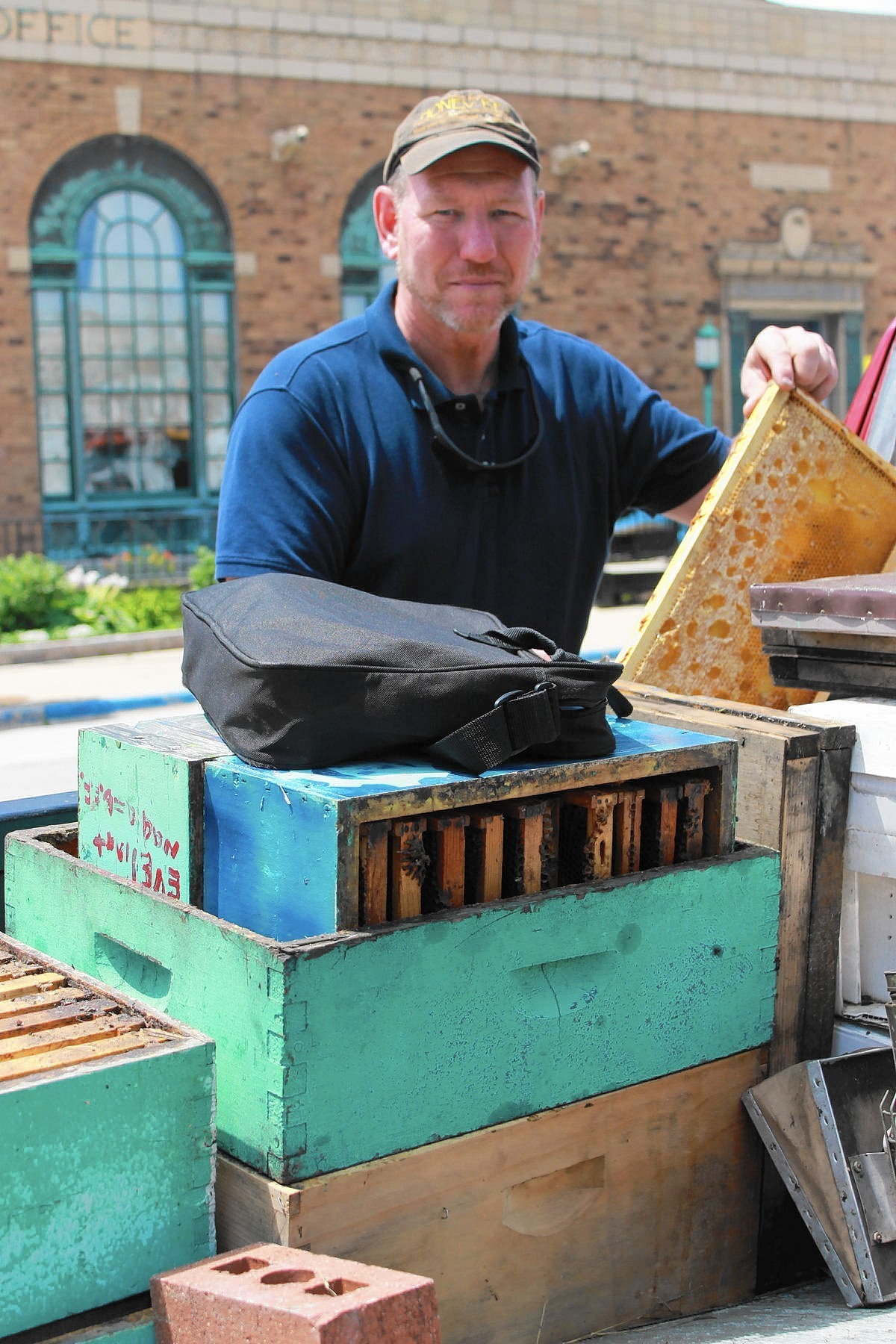 Beekeeper educates people about honey
