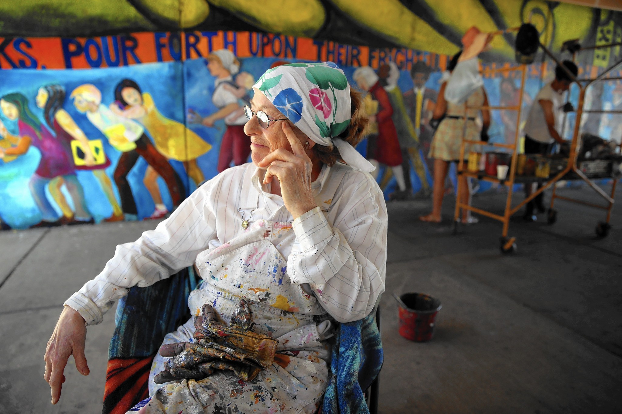 Hyde Park mural artist returns decades later to give worn art new life